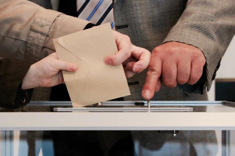 Ballot paper being put into ballot box
