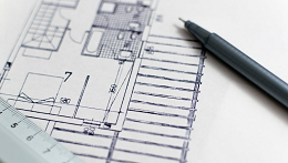 construction building plan with pen and ruler