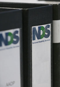 Two binders next to each other with the NDS logo.