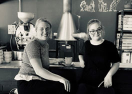 Photo of Employer and Employee sitting in a cafe.