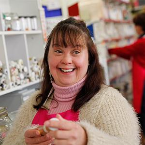 woman smiling while holding something